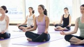 Women practicing yoga in a class